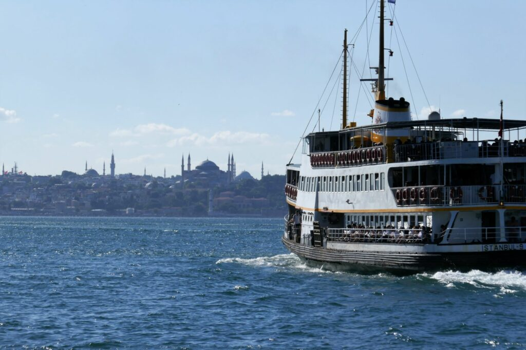 Ferry on water in Istanbul skyline